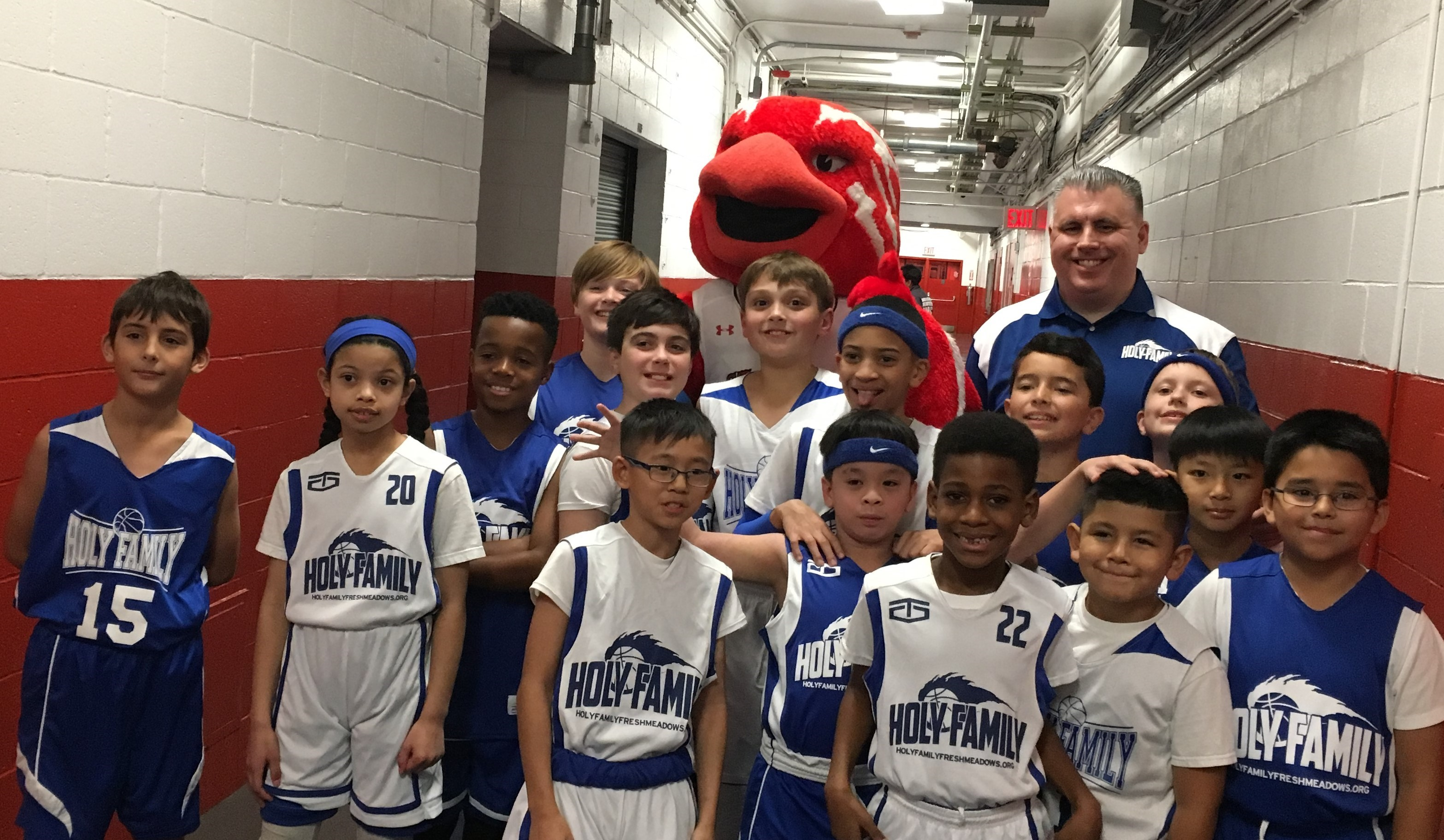 Holy Family Catholic Academy students in basketball uniforms