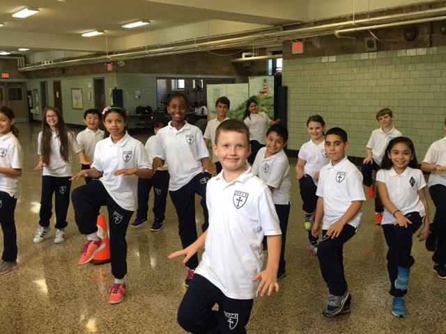 Holy Family Catholic Academy students exercising
