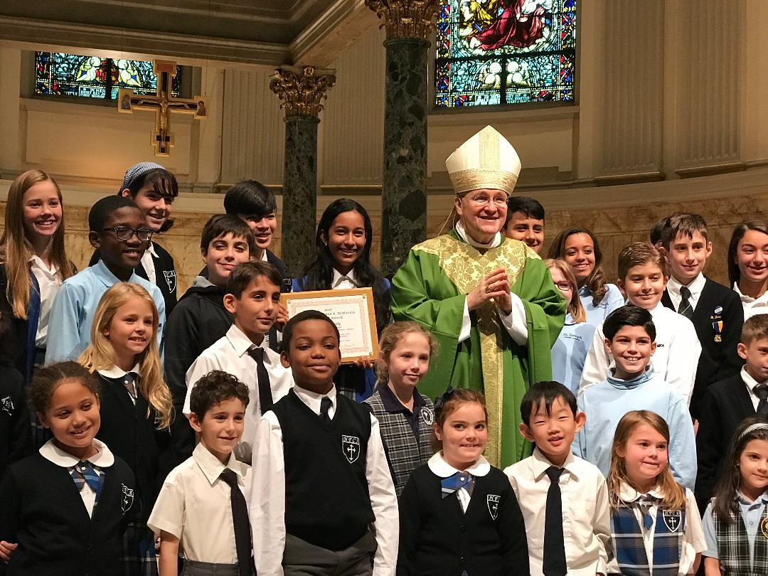 Holy Family Catholic Academy students with bishop